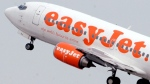 An easyJet aircraft takes off from Ciampino airport in Rome, Italy, on Aug. 30, 2004. (Corrado Giambalvo / AP)