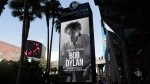 A sign outside of the Cosmopolitan of Las Vegas congratulates Bob Dylan after he won the 2016 Nobel Prize in literature. (AP Photo/John Locher)