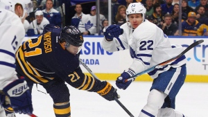 Buffalo Sabres Kyle Okposo (21) gets a shot past Toronto Maple Leafs Nikita Zaitsev (22) during the first period of an NHL hockey game, Thursday, Nov. 3, 2016, in Buffalo, N.Y. (Jeffrey T. Barnes/AP)