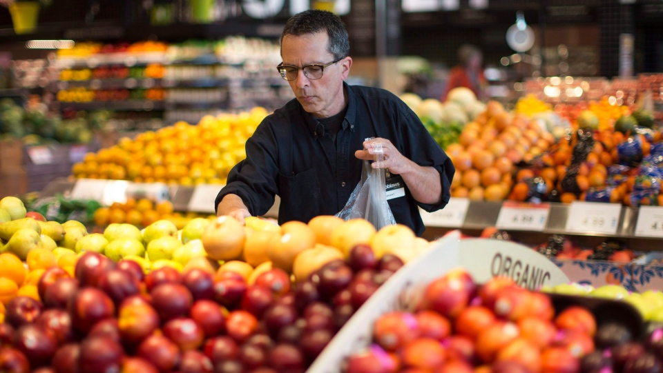 Grant Bone, Department Manager for Loblaws 'Click and Collect' gathers a customer's order at one of the grocery chain's outlets in Toronto on Thursday, June 16, 2016. (The Canadian Press/Chris Young)