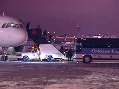 Players from the Canadiens' get off their plane after landing in Montreal on Thursday night, Feb. 19, 2009.