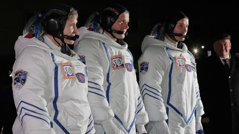 From left: U.S. astronaut Peggy Whitson, Russian cosmonaut Oleg Novitsky and French astronaut Thomas Pesquet, at Baikonur cosmodrome, Kazakhstan, on Nov. 17, 2016. (Dmitri Lovetsky / AP)