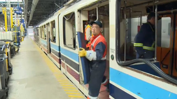 Calgary Transit employees remove the seats from car 2001
