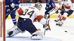 Florida Panthers goalie James Reimer makes a save as Toronto Maple Leafs centre Mitchell Marner and Florida Panthers defenceman Michael Matheson look for the rebound during second period NHL hockey action in Toronto on Thursday, Nov. 17, 2016. (Nathan Denette / THE CANADIAN PRESS)