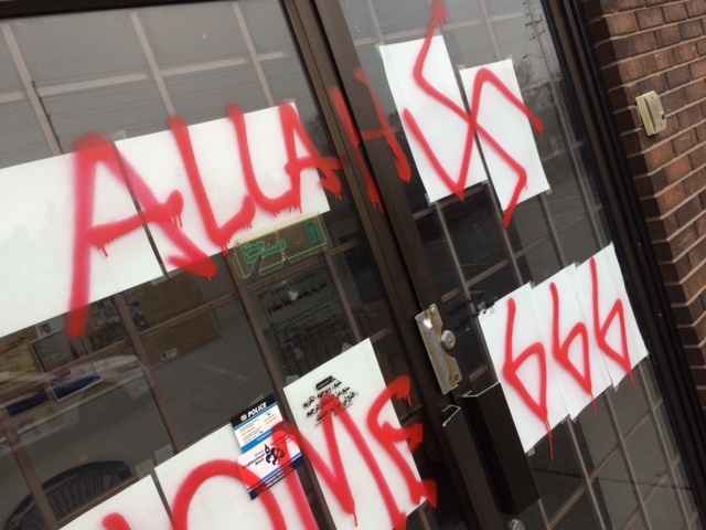 Hate graffiti was spray-painted on the doors of the Ottawa Mosque on Northwestern Avenue overnight on Thursday, Nov. 17, 2016. (Jim O'Grady/CTV Ottawa)