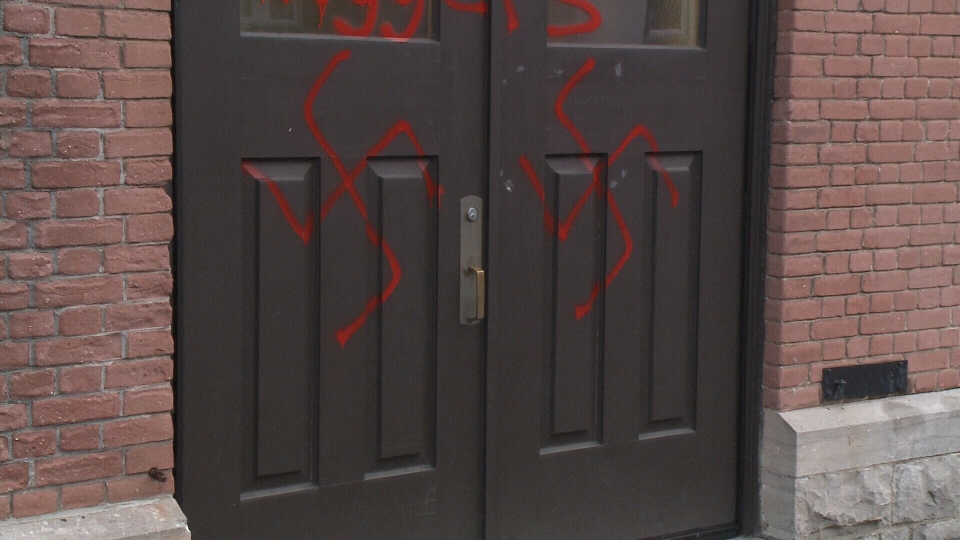 Red swastikas and racial slurs were spray-painted on the doors of Parkdale United Church overnight Thursday, Nov. 17, 2016. (Jim O'Grady/CTV Ottawa)