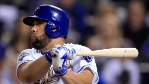 Kansas City Royals designated hitter Kendrys Morales watches his RBI single during the sixth inning of a baseball game against the Chicago White Sox at Kauffman Stadium in Kansas City, Mo., Friday, Sept. 16, 2016. (AP Photo/Orlin Wagner)