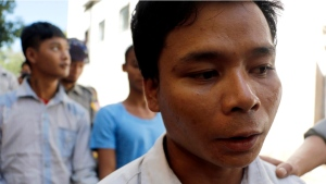 Tun Naing, an exorcist who was arrested after killing three young children during an exorcism ritual, talks to journalists upon his arrival at a district court to hear his first trial Friday, Nov. 18, 2016, in Twante, south of Yangon, Myanmar. (Thein Zaw/AP Photo)