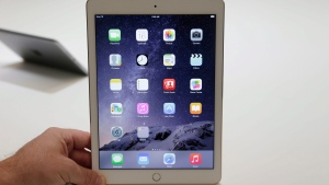 FILE - This Oct. 16, 2014, file photo, shows the iPad Air 2 at Apple headquarters in Cupertino, Calif. (AP Photo/Marcio Jose Sanchez, File)
