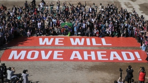 Participants at the COP22 climate conference stage a public show of support for climate negotiations and Paris agreement, on the last day of the conference, in Marrakech, Morocco, Friday, Nov. 18, 2016. (David Keyton/AP Photo)