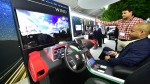 A man tests a connected and autonomous vehicle with software framework provided by Wind River, a leader in embedded software for intelligent connected systems, on November 15, 2016 in Los Angeles, California, inside the Technology Pavilion at the 2016 Los Angeles Autoshow, now called Automcobility LA. © FREDERIC J. BROWN / AFP
