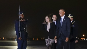 President Barack Obama walks across the tarmac with Second Vice-President of Peru Mercedes Araoz, center, during his arrival at Jorge Chavez International Airport in Lima, Peru, Friday, Nov. 18, 2016 (AP / Pablo Martinez Monsivais)