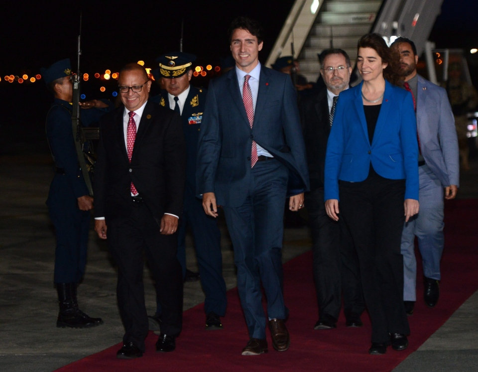 Prime Minister Justin Trudeau walks with Peru's Minister of Energy and Mines Gonzalo Tamayo and Canada's Ambassador to Peru Gwyn Kutz as he arrives in Lima, Peru on Friday, Nov. 18, 2016. (Sean Kilpatrick / THE CANADIAN PRESS)