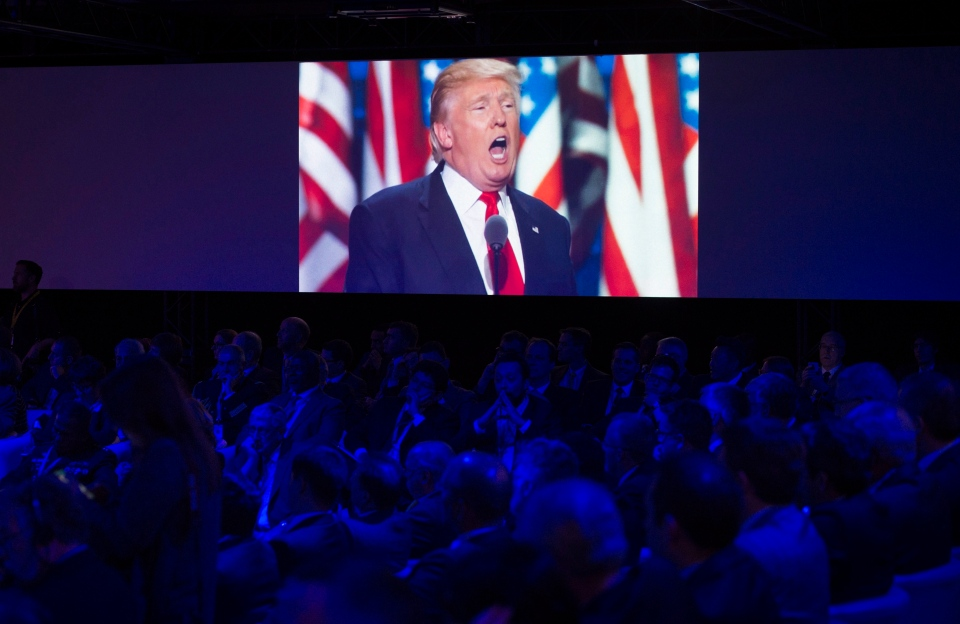 A video screen displays images of US President-Elect Donald Trump during the Halifax International Security Forum in Halifax on Friday, November 18, 2016. (Darren Calabrese / THE CANADIAN PRESS)