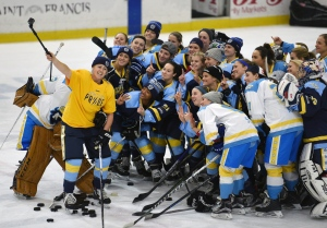 "In this Sunday, Jan. 24, 2016 photo, National Women's Hockey League All-Star players take time for a ""selfie"" before the start of an all-star game at Harborcenter in Buffalo, N.Y. (AP / Gary Wiepert)"