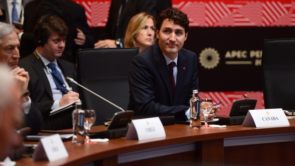 Prime Minister Justin Trudeau takes part in a TPP meeting during the APEC Summit in Lima, Peru on Saturday, Nov. 19, 2016. (THE CANADIAN PRESS / Sean Kilpatrick)