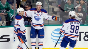 Edmonton Oilers' Andrej Sekera (2) of Slovakia and Jesse Puljujarvi (98) of Sweden celebrate with Connor McDavid after McDavid scored in the third period of an NHL hockey game against the Dallas Stars on Saturday, Nov. 19, 2016, in Dallas. The score was McDavid's third of the game. (AP Photo  / Tony Gutierrez)
