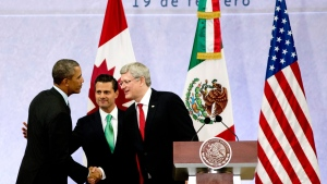 President Barack Obama, left, Mexico's President Enrique Pena Nieto, center, and the Prime Minister of Canada, Stephen Harper, shake hands at the end of a news conference concluding the North American Leaders Summit in Toluca, Mexico, Wednesday, Feb. 19, 2014. The leaders met in part to highlight the economic cooperation that has grown since NAFTA joined the U.S., Canada and Mexico 20 years ago. (AP Photo/Eduardo Verdugo)