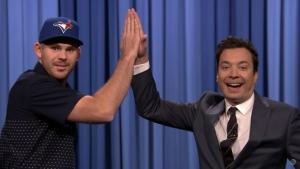 The Tonight Show's Jimmy Fallon and the Toronto Blue Jays' Joe Biagini share a high-five. (The Tonight Show Starring Jimmy Fallon/Youtube)