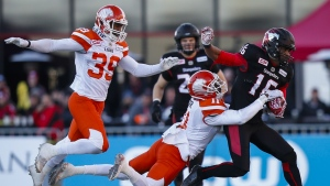 B.C. Lions' Mike Edem, centre, grabs for the ball from Calgary Stampeders' Marquay McDaniel, right, as Chandler Fenner, far left, looks on during second quarter CFL Western Final football action in Calgary on Sunday, Nov. 20, 2016. (Todd Korol / THE CANADIAN PRESS)
