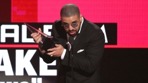 "Drake accepts the award for favorite album rap/hip-hop for ""Views"" at the American Music Awards at the Microsoft Theater on Sunday, Nov. 20, 2016, in Los Angeles. (Photo by Matt Sayles/Invision/AP)"
