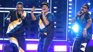 Bruno Mars, center, performs '24K Magic' at the American Music Awards at the Microsoft Theater on Sunday, Nov. 20, 2016, in Los Angeles. (Photo by Matt Sayles/Invision/AP)
