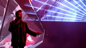 The Weeknd performs 'Starboy' at the American Music Awards at the Microsoft Theater on Sunday, Nov. 20, 2016, in Los Angeles. (Photo by Matt Sayles/Invision/AP)