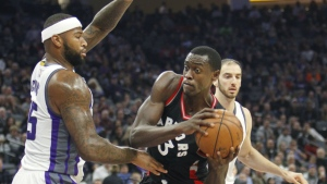 Toronto Raptors forward Pascal Siakam looks for an opening around Sacramento Kings defender DeMarcus Cousins during the first half of an NBA basketball game in Sacramento, Calif. on Sunday, Nov. 20, 2016. (AP / Steve Yeater)