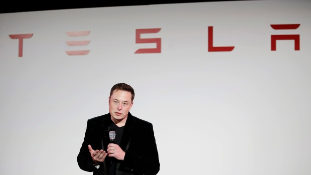 Tesla to Hold Musk to a Higher Standard for Compensation