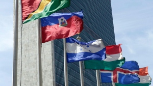 In this June 1, 2016 photo, flags of some of the 193 countries fly in the breeze in front of the Secretariat building of the United Nations.  (AP Photo/Richard Drew)