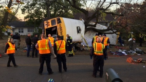 In this photo provided by the Chattanooga Fire Department via Chattanooga Times Free Press, Chattanooga Fire Department personnel work the scene of a fatal elementary school bus crash in Chattanooga, Tenn., Monday, Nov. 21, 2016. (Bruce Garner/Chattanooga Fire Department via Chattanooga Times Free Press via AP)