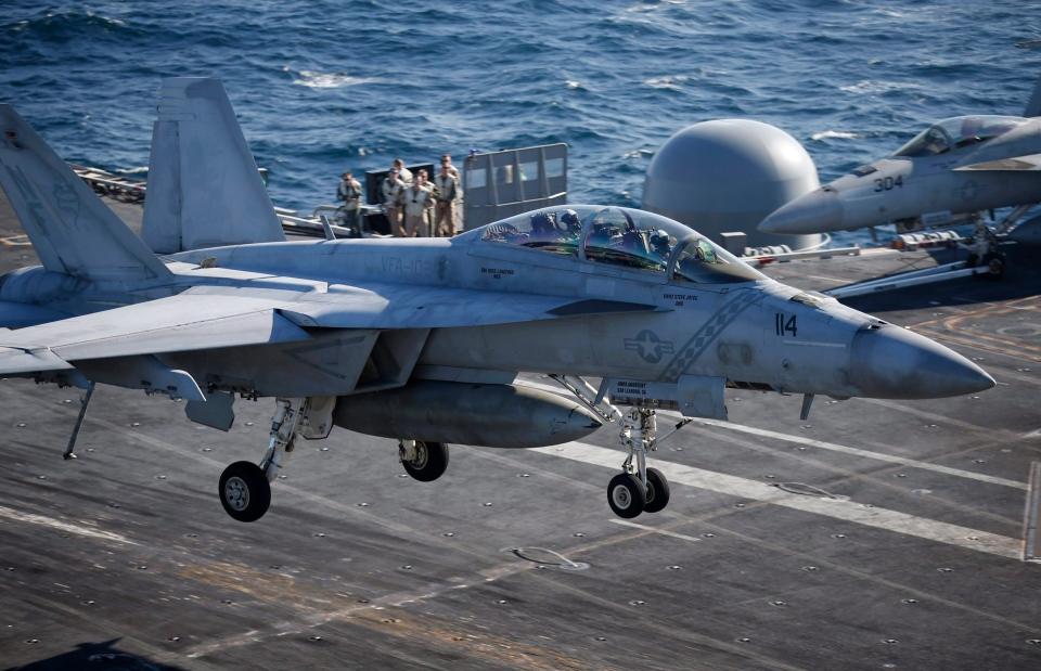 A U.S. Navy F/A-18 Super Hornet fighter lands onto the deck of the USS Ronald Reagan, a Nimitz-class nuclear-powered super carrier, during a joint naval drill between South Korea and the U.S. in the West Sea, South Korea, Wednesday, Oct. 28, 2015. (AP Photo / Kim Hong-Ji)