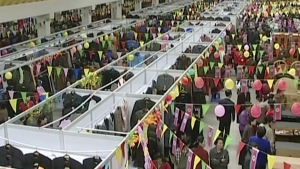 People shop in the Tongil Market in Pyongyang, North Korea on March 13, 2004. (AP)