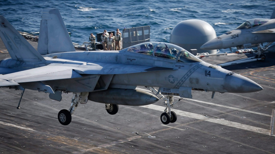 A U.S. Navy F/A-18 Super Hornet fighter lands onto the deck of the USS Ronald Reagan in the West Sea, South Korea, on Oct. 28, 2015. (Kim Hong-Ji / Pool Photo via AP)