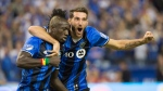 Montreal Impact Dominic Oduro celebrates with Ignacio Piatti during the MLS East final at the Olympic Stadium Tuesday, November 22, 2016 in Montreal. THE CANADIAN PRESS/Paul Chiasson