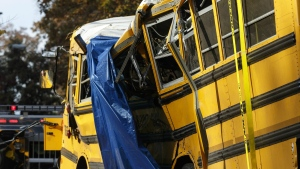 A tarp covers a section of the wreckage the day after a school bus accident, Tuesday, Nov. 22, 2016, in Chattanooga, Tenn. (Doug Strickland/Chattanooga Times Free Press via AP)