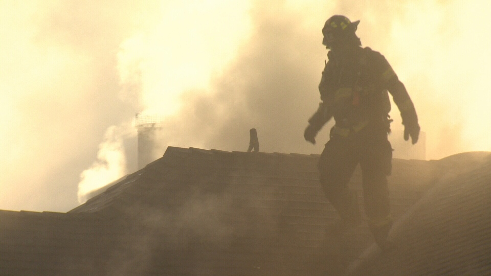 Firefighters could be seen on the roof attacking flames shooting from the chimney more than an hour after a blaze broke out at Spinnakers brew pub in Vic West. Nov. 23, 2016. (CTV Vancouver Island)