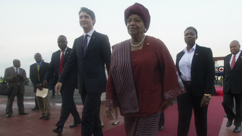 Canadian Prime Minister Justin Trudeau walks with Liberian President Ellen Johnson Sirleaf as he arrives in Monrovia, Liberia Thursday, Nov. 24, 2016. (Adrian Wyld / THE CANADIAN PRESS)