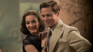 "In this image released by Paramount Pictures, Marion Cotillard, left, and Brad Pitt appear in a scene from ""Allied."" (Daniel Smith/Paramount Pictures via AP)"