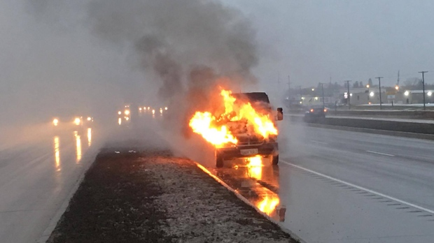 Firefighters extinguished a van fire on the south Perimeter Highway near St. Anne's Road on Thursday. (Source: Neil Crockford)