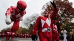 A balloon operator waves to spectators while guiding the Red Ranger balloon along West Central Park during the Macy's Thanksgiving Day parade, Thursday, Nov. 24, 2016, in New York. (AP / Julie Jacobson)