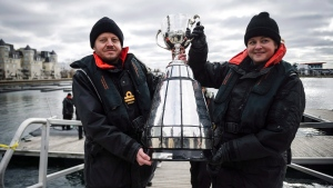Royal Canadian Naval officers carry the Grey Cup as it is transported from a RHIB (Rigged Hull Inflatable Boat) to the HMCS York in Toronto on Tuesday, Nov. 22, 2016. (THE CANADIAN PRESS/Christopher Katsarov)
