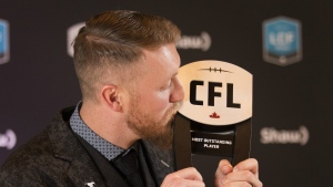 Calgary Stampeders quarterback Bo Levi Mitchell poses backstage after being named Most Outstanding Player at the CFL Awards held in Toronto on Thursday, Nov. 24, 2016. (Peter Power / THE CANADIAN PRESS)