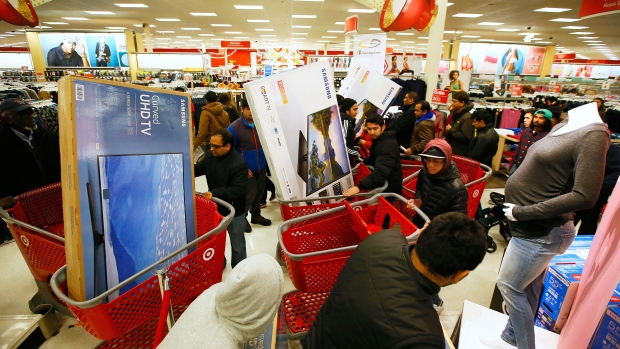 Guests take advantage of Target's Black Friday electronics sales on Thursday, Nov. 24, 2016, in Jersey City, N.J. (Photo by Noah K. Murray/Invision for Target/AP Images)