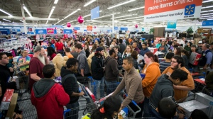 Excited customers shop Walmart's Black Friday event in Bentonville, AR, on Nov. 24, 2016. The retailer stocked its physical and digital aisles with the season's hottest items. (Gunnar Rathbun/AP Images for Walmart)