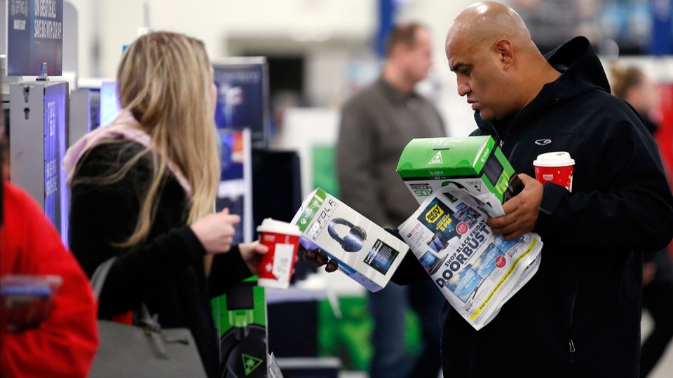 Shoppers browse items at a Best Buy store on Friday, Nov. 25, 2016, in Skokie, Ill. (AP / Nam Y. Huh)