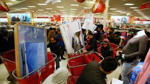 Guests take advantage of Target's Black Friday electronics sales on Thursday, Nov. 24, 2016, in Jersey City, N.J. (AP / Noah K. Murray / Invision for Target)