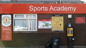 A sign for the sports academy of the English soccer team Crewe Alexandra at the Alexandra Stadium, in Crewe northern England Friday Nov. 25, 2016.  (Martin Rickett/PA via AP)