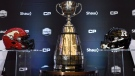 The Grey Cup and helmets from the Calgary Stampeders and Ottawa Redblacks are on display before a press conference in Toronto on Wednesday, November 23, 2016. The Grey Cup takes place on Sunday. THE CANADIAN PRESS/Nathan Denette
