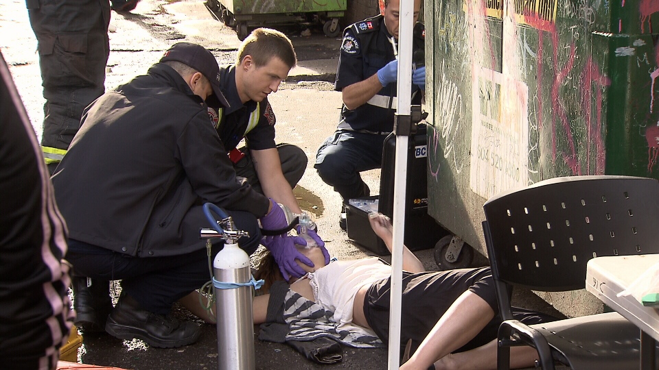 First responders tend to an overdose victim in Vancouver's Downtown Eastside. B.C. has revealed there were a record 494 overdose-related 911 calls in a single week this month. (CTV)